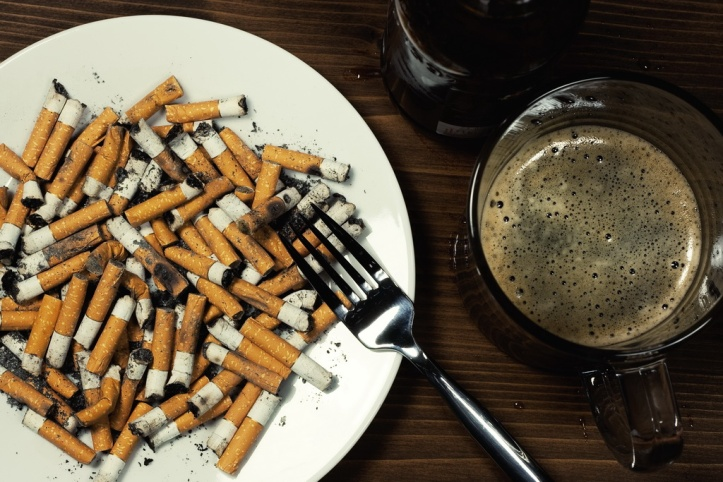 Plate with cigarettes stubs